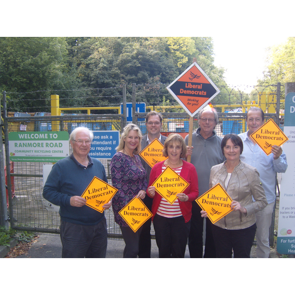 Lib Dem activists campaign outside one of Surrey's rubbish tips