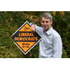 Will Forster with Lib Dem sign