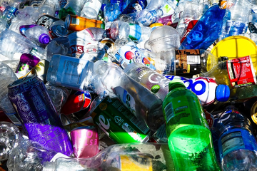 Piles of plastic bottles for recycling (Nick Fewings on Unsplash)