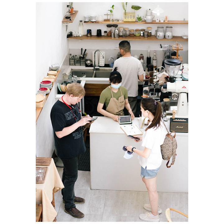 People standing at cafe counter